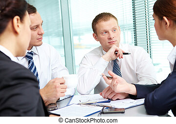 Meeting - Image of confident colleagues listening to new...