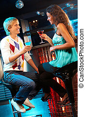 Couple in the bar - Portrait of attractive couple chatting...