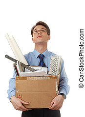 Office worker - Portrait of businessman holding box with...