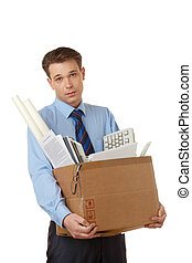 Leaving - Portrait of businessman holding box with office...
