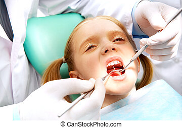 Child at the dentistry - Photo of small girl with open mouth...