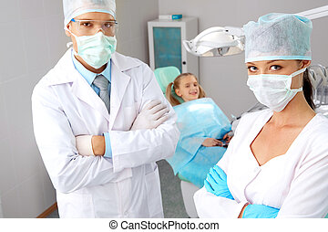 Young dentists - Portrait of pretty assistant and dentist in...
