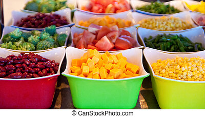 Cheese and Vegetables on Salad Bar - Containers of fresh...