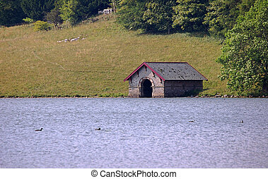 Boathouse on Malham Tarn with waterfowl in foreground