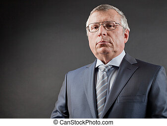 Mature businessman - Photo of senior employer looking at...