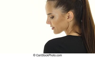 Girl winks in the spacious room. White background. Close up...