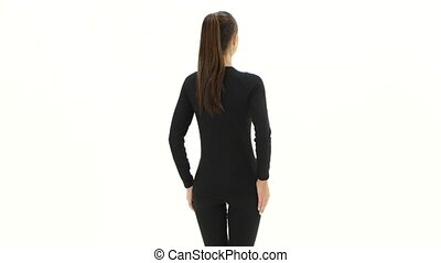 Girl advertises clothes. White background. Back view - Girl...