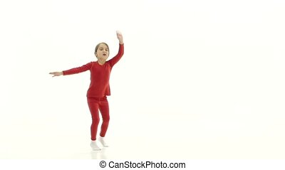 Child jumps up and has fun. White background. Slow motion -...