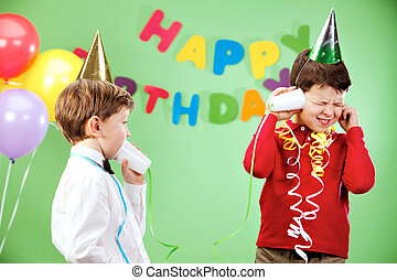 Telephone conversation - Portrait of happy boys playing with...