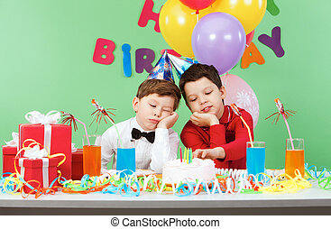 Boring birthday - Portrait of two boys boring during...