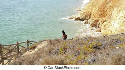 woman walking up on nature - Sporty young woman walking up...