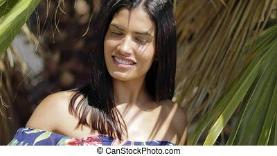 Charming model posing in palms - Portrait of wonderful young...