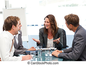 Businesswoman laughing with a team