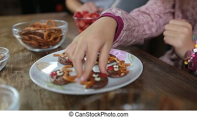 Many hands taking homemade sweets from the plate - Many...