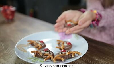Child's hands offering delicious homemade cookie - Closeup...