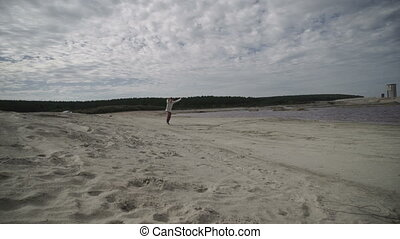 Man doing back flip on beach - Unrecognizable man doing back...