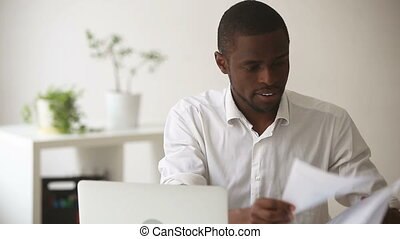 Stressed angry african businessman quits tired of difficult...