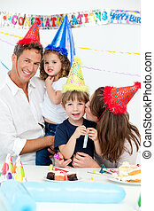 Portrait of a happy family during a birthday party at home