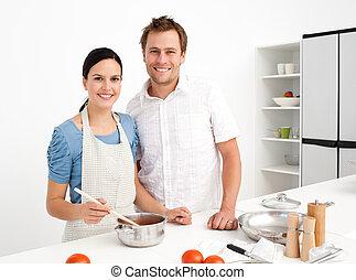Portrait of a happy couple preparing a bolognese sauce