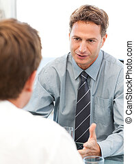 Charismatic manager during a meeting with an employee at the...
