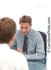 Charismatic manager during an interview with an employee at...