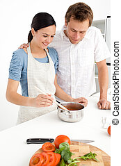 Lovely couple preparing a bolognese sauce together