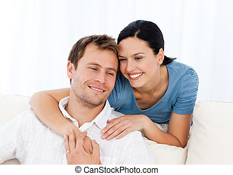 Lovely woman hugging her boyfriend while relaxing on the...