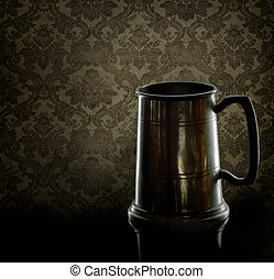 Old pewter drinking mug, tankard. With back lighting and old...