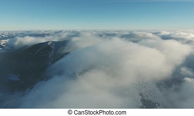 Aerial view of nature in winter. Hills covered in snow....