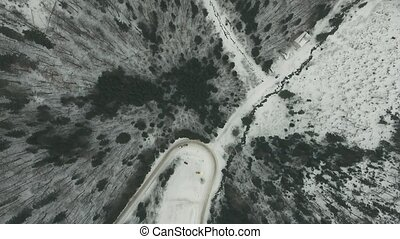 Aerial view of a cars driving on a slippery road in winter....