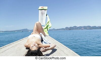 Beautiful Brunette Woman Lying On Thailand Boat Nose, Young...
