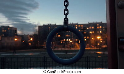 Sports ring on apartment block background in late evening -...