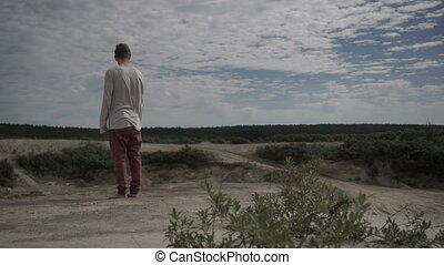 A man admiring the beautiful view - Unrecognizable man...
