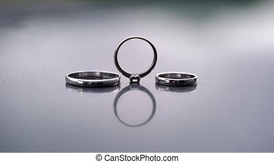 Wedding rings with reflection and light