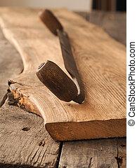 Old wood plane on oak plank - Old wood plane on a rustic oak...