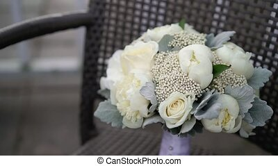 Bridal bouquet on chair at cloudy day