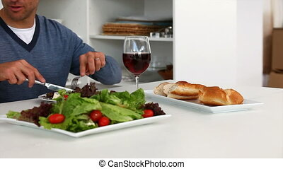 Couple eating salad with wine