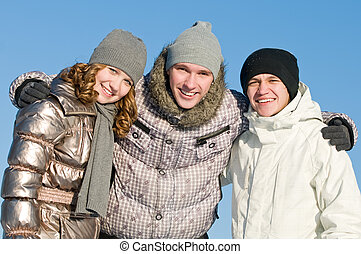 smiling young people group in winter
