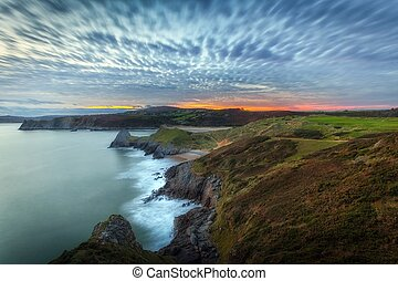 Blue hour at Three Cliffs Bay - Quilted clouds and a blue...