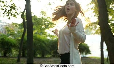 Happy woman autumn park - Happy woman in autumn park. Slow...