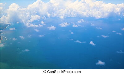 Traveling by air above clouds. View through an airplane...