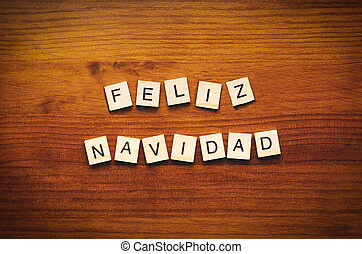 Feliz Navidad text on a wooden background