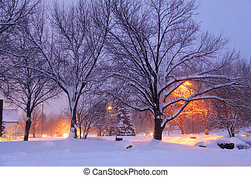 Winter scene with street lights lit on early morning