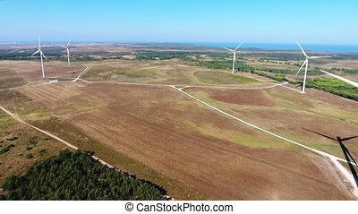 Aerial. Video shooting flight over wind generators at Costa...