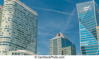 Modern skyscrapers timelapse in famous financial and business district of Paris - La Defense.