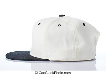 Profile view of white baseball cap isolated on white...