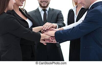 friendly business team with hands clasped together. -...