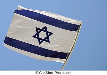 State Flag of Israel - State flag of Israel against blue sky...