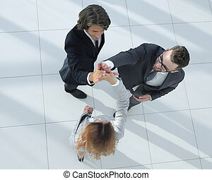 Business people giving high five staying in the office -...