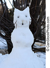 snow cat - Cat snowman with tree branches for whiskers....